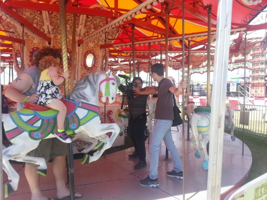 Filming me and Madeline riding on the carousel this weekend.